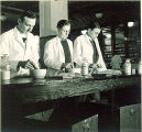 Pharmacy students using mortars and pestles in laboratory work, The University of Iowa, 1940s