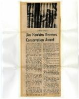 Jim Hawkins receives conservation award.