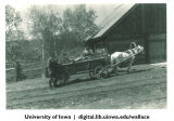 Men with horse-drawn cart, Siberia, 1944