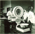 Pharmacy students working in laboratory with a scale, The University of Iowa, 1940s