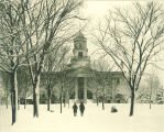 Pedestrians  walking in snow in front of Old Capitol, The University of Iowa, February 3, 1896
