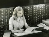 Student checking reference material, 1948