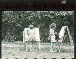 Girls painting pictures at preschool, The University of Iowa, 1920s