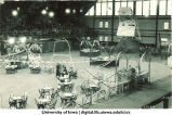 Field House set up with tables, decorations and booths with audience, The University of Iowa, 1923