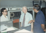 Somnuk Sriplung telling Earl Heady about upgraded equipment at the Office of Agricultural Economics computer center in Bangkok, Thailand, 1983.