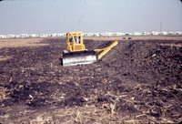Farm land being leveled, 1983