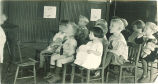 Children seated in playroom, The University of Iowa, 1920s