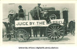 Distillation apparatus on parade float, The University of Iowa, 1910s