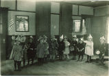 Parade of small children in hats with musical instruments, The University of Iowa, 1920s