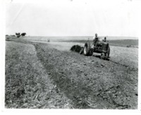 Bill Kinen constructing terraces on Paul Sam's farmland.