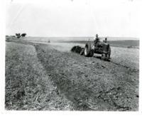 Bill Kinen constructing terraces on Paul Sam's farmland.