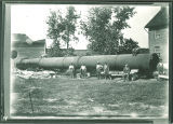 Workmen in front of a smokestack on the ground, The University of Iowa, 1890s