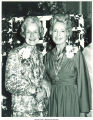 Mary Louise Smith with friend in front of trellis at National Women's Republican Club, New York, N.Y., March 22, 1975