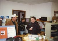1996 - Charles Neeley, Jim Jensen, and Drew DeLang stand at open house party