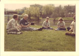 Music lessons for Scottish Highlander members on east bank  of Iowa River, The University of Iowa, 1970s