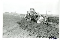 Art Salzman tiling machine on Wallace Riepe farm, 1952