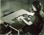 Student working with electrical devices in engineering laboratory, The University of Iowa, 1939