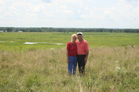 Unidentified couple in pasture land