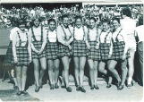 Scottish Highlanders dancer Ellen Thomson and group at sporting event, The University of Iowa, 1980s?