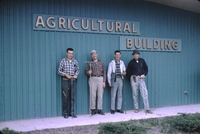 Ivan Jansen, Dale Lockridge, Mack Miller, and Roy Smith in front of the agricultural building.