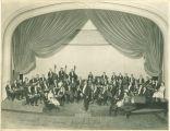 University orchestra seated in Macbride Hall auditorium, The University of Iowa, 1920s