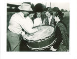 Man signing Scottish Highlanders drum, Colorado, September 14, 1953