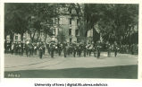 Marching band leading parade for Induction ceremony, The University of Iowa, 1920s