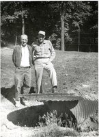 Two men and drainage structure