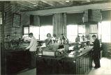 Pharmacy students experimenting in pharmacy laboratory, The University of Iowa, 1920s