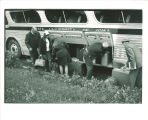 Loading luggage onto bus for Scottish Highlanders tour, The University of Iowa, 1960s