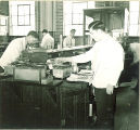 Pharmacy students working in a laboratory, The University of Iowa, 1940s