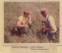 Dennis Rustman and Bill Welker Examine a Field.