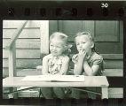 Girls reading outdoors, The University of Iowa, May 10, 1941