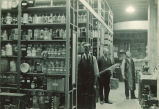 Men in a chemistry storage room, The University of Iowa, 1930s