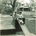 Children climbing on wood platforms and slides, The University of Iowa, May 28, 1941