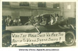 Engineers in tuxedos and top hats in Mecca Day parade, The University of Iowa, 1919