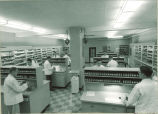 Pharmacy students preparing drugs in pharmacy, The University of Iowa, May 1957