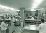 Pharmacy students preparing drugs in pharmacy, The University of Iowa, May 1957