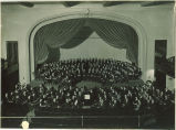University orchestra and chorus assembled for performance of Childhood of Christ by Hector Berlioz, The University of Iowa, December 25, 1923