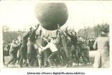 Students playing push ball outdoors, The University of Iowa, 1914