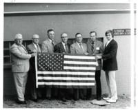 Group of Men holding the American Flag