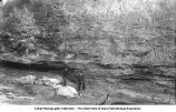 Men by conglomerate basal with lentils of unconformity near base, Montpelier, Iowa, late 1890s or early 1900s
