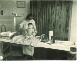 Measuring a baby's growth, The University of Iowa, 1920s