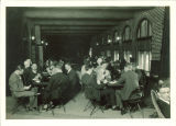 Students playing cards on sunporch in Iowa Memorial Union, the University of Iowa, 1927