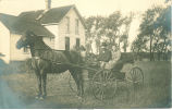 Couple in horse-drawn carriage, Lamont, Iowa, 1900s