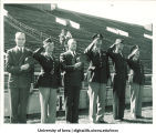 Robert D. Blue and Virgil M. Hancher with R.O.T.C. officers at Iowa Stadium on Governor's Day, The University of Iowa, April 29, 1948