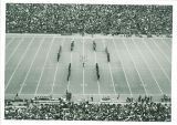 Scottish Highlanders in formation on football field, The University of Iowa, 1960s?