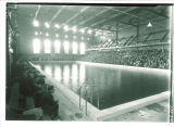 Swimming pool with crowd at the Field House, the University of Iowa, 1920s