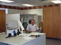 2003 -  District Employee Dale Schmeiser sits in his office at the Des Moines County Soil and Water Conservation District office
