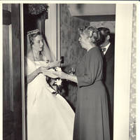 Frindy, Elizabeth and unknown man in front hall with correspondance